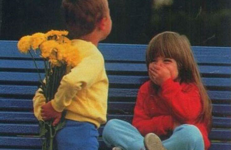 boy give girl a flower
